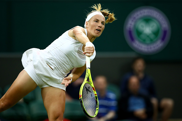 LONDON, ENGLAND - JUNE 28:  Svetlana Kuznetsova of Russia serves during the Ladies Singles first round match against Caroline Wozniacki of Denmark on day two of the Wimbledon Lawn Tennis Championships at the All England Lawn Tennis and Croquet Club on June 28, 2016 in London, England.  (Photo by Clive Brunskill/Getty Images)