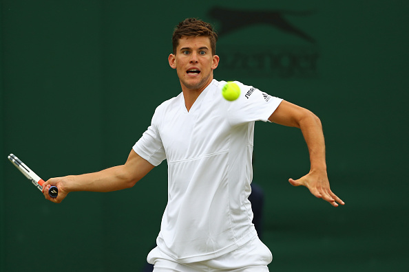 LONDON, ENGLAND - JUNE 28:  Dominic Thiem of Austria plays a forehand during the Men's Singles first round match against Florian Mayer of Germany on day two of the Wimbledon Lawn Tennis Championships at the All England Lawn Tennis and Croquet Club on June 28, 2016 in London, England.  (Photo by Julian Finney/Getty Images)