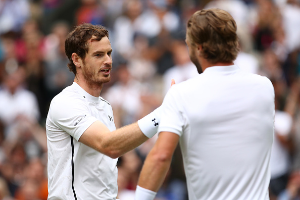 LONDON, ENGLAND - JUNE 28:  Andy Murray of Great Britain and Liam Broady of Great Britain shake hands during the Men's Singles first round match on day two of the Wimbledon Lawn Tennis Championships at the All England Lawn Tennis and Croquet Club on June 28, 2016 in London, England.  (Photo by Clive Brunskill/Getty Images)