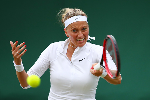 LONDON, ENGLAND - JUNE 29:  Petra Kvitova of The Czech Republic plays a forehand during the Ladies Singles second round match against Sorana Cirstea of Romania on day three of the Wimbledon Lawn Tennis Championships at the All England Lawn Tennis and Croquet Club on June 29, 2016 in London, England.  (Photo by Clive Brunskill/Getty Images)