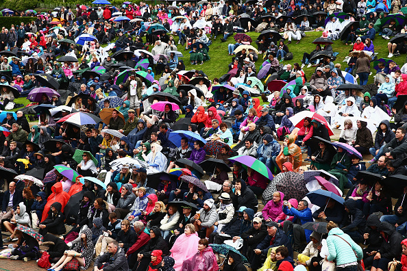 LONDON, ENGLAND - JUNE 29:  Supporters sit on Murray mound as they take cover from the rain on day three of the Wimbledon Lawn Tennis Championships at the All England Lawn Tennis and Croquet Club on June 29, 2016 in London, England.  (Photo by Jordan Mansfield/Getty Images)