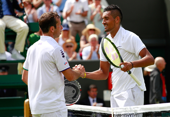 LONDON, ENGLAND - JUNE 28:  Nick Kyrgios of Australia and  Radek Stepanek of The Czech Republic shake hands following the Men's Singles first round match on day two of the Wimbledon Lawn Tennis Championships at the All England Lawn Tennis and Croquet Club on June 28, 2016 in London, England.  (Photo by Adam Pretty/Getty Images)