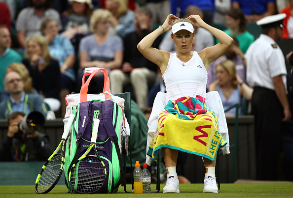 LONDON, ENGLAND - JUNE 28:  Caroline Wozniacki of Denmark looks on following defeat during the Ladies Singles first round match against Svetlana Kuznetsova of Russia on day two of the Wimbledon Lawn Tennis Championships at the All England Lawn Tennis and Croquet Club on June 28, 2016 in London, England.  (Photo by Clive Brunskill/Getty Images)