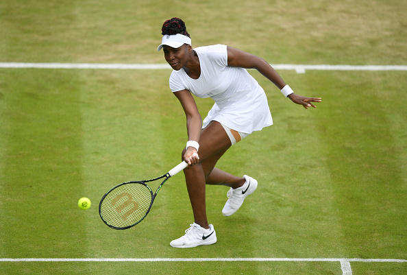 LONDON, ENGLAND - JUNE 30:  Venus Williams of The United States plays a forehand during the Ladies Singles second round match against Maria Sakkari of Greece on day four of the Wimbledon Lawn Tennis Championships at the All England Lawn Tennis and Croquet Club on June 30, 2016 in London, England.  (Photo by Shaun Botterill/Getty Images)