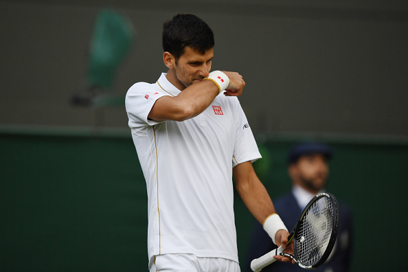 LONDON, ENGLAND - JULY 01:  Novak Djokovic of Serbia looks dejected during the Men's Singles third round match against Sam Querrey of The United States on day five of the Wimbledon Lawn Tennis Championships at the All England Lawn Tennis and Croquet Club on July 1, 2016 in London, England.  (Photo by Shaun Botterill/Getty Images)