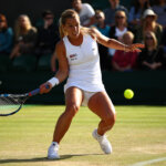 LONDON, ENGLAND - JULY 02:  Dominika Cibulkova of Slovakia plays a forehand during the Ladies Singles third round match against Eugenie Bouchard of Canada on day six of the Wimbledon Lawn Tennis Championships at the All England Lawn Tennis and Croquet Club on July 2, 2016 in London, England.  (Photo by Clive Brunskill/Getty Images)