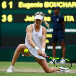 LONDON, ENGLAND - JUNE 30:  Eugenie Bouchard of Canada plays a backhand during the Ladies Singles second round match against Johanna Konta of Great Britain on day four of the Wimbledon Lawn Tennis Championships at the All England Lawn Tennis and Croquet Club on June 30, 2016 in London, England.  (Photo by Adam Pretty/Getty Images)