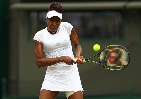 LONDON, ENGLAND - JULY 05: Venus Williams of The United States plays a backhand during the Ladies Singles Quarter Finals match against Yaroslava Shvedova of Kazakhstan on day eight of the  Wimbledon Lawn Tennis Championships at the All England Lawn Tennis and Croquet Club on July 5, 2016 in London, England.  (Photo by Julian Finney/Getty Images)