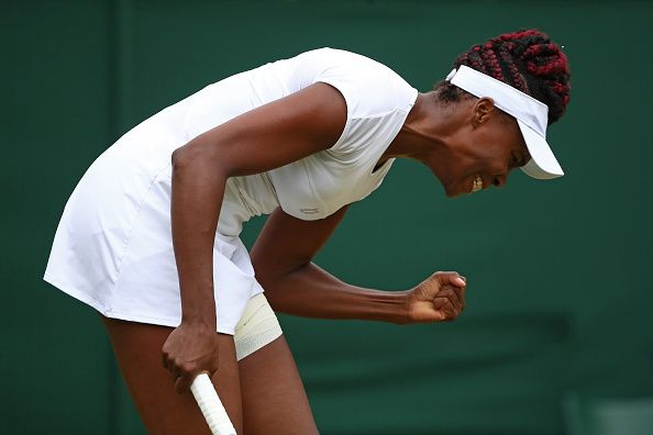 LONDON, ENGLAND - JULY 04:  Venus Williams of The United States reacts during the Ladies Singles fourth round match against Carla Suarez Navarro of Spain on day seven of the Wimbledon Lawn Tennis Championships at the All England Lawn Tennis and Croquet Club on July 4, 2016 in London, England.  (Photo by Clive Brunskill/Getty Images)