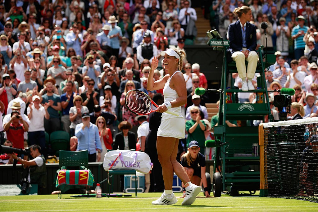LONDON, ENGLAND - JULY 05:  Angelique Kerber of Germany celebrates victory during the Ladies Singles Quarter Finals match against Simona Halep of Romania on day eight of the  Wimbledon Lawn Tennis Championships at the All England Lawn Tennis and Croquet Club on July 5, 2016 in London, England.  (Photo by Adam Pretty/Getty Images)