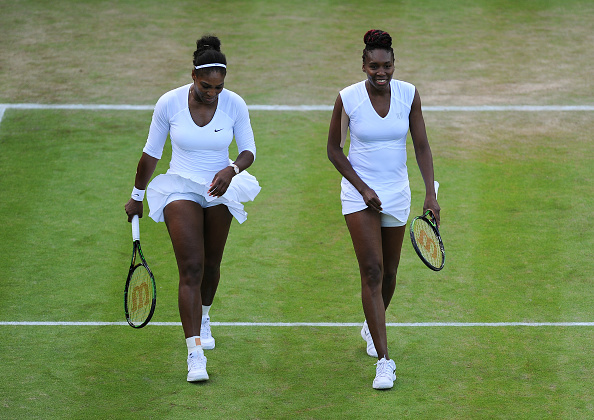 LONDON, ENGLAND - JULY 02: Serena and Venus Williams in action during their womens doubles match against Elise Martens and An-Sophie Mestach on day six of the Wimbledon Lawn Tennis Championships at the All England Lawn Tennis and Croquet Club on July 2, 2016 in London, England.  (Photo by Visionhaus/Corbis via Getty Images)
