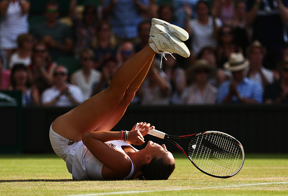 LONDON, ENGLAND - JULY 04:  Jelena Jankovic of Serbia celebrates match point in her Ladies' Singles third Round match against Petra Kvitova of Czech Republic during day six of the Wimbledon Lawn Tennis Championships at the All England Lawn Tennis and Croquet Club on July 4, 2015 in London, England.  (Photo by Clive Brunskill/Getty Images)