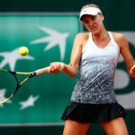 PARIS, FRANCE - MAY 28:  Sesil Karatantcheva of Bulgaria returns a shot during her women's singles match against Irina Falconi of the United States on day five of the 2015 French Open at Roland Garros on May 28, 2015 in Paris, France.  (Photo by Julian Finney/Getty Images)