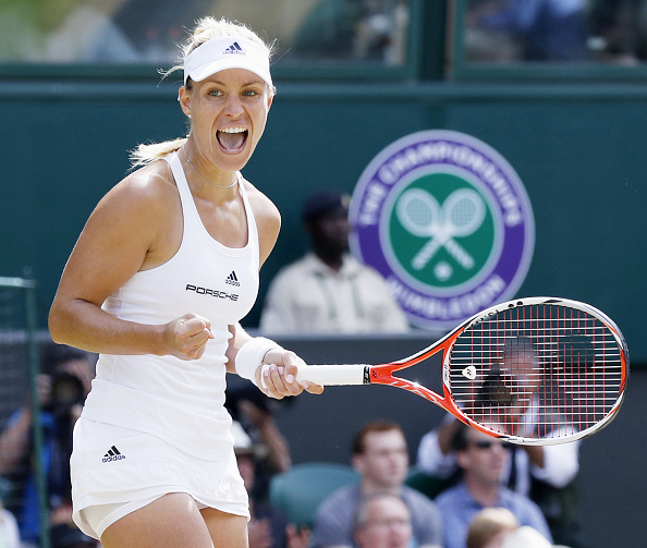 Angelique Kerber of Germany pumps her fist after winning the first set in her semifinal match against Venus Williams at the Wimbledon championships in London on July 7, 2016. Kerber won 6-4, 6-4 to reach the final against defending champion Serena Williams. (Photo by Kyodo News via Getty Images)