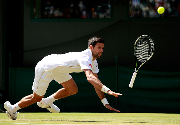 LONDON, ENGLAND - JULY 02:  Novak Djokovic of Serbia slips during the Men's Singles third round match against Sam Querrey of The United States on day six of the Wimbledon Lawn Tennis Championships at the All England Lawn Tennis and Croquet Club on July 2, 2016 in London, England.  (Photo by Adam Pretty/Getty Images)