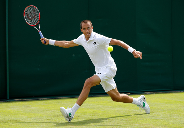 LONDON, ENGLAND - JUNE 27:  Lukas Rosol of The Czech republic plays a forehand shot during the Men's Singles first round match against Sam Querrey of The United States on day one of the Wimbledon Lawn Tennis Championships at the All England Lawn Tennis and Croquet Club on June 27th, 2016 in London, England.  (Photo by Adam Pretty/Getty Images)