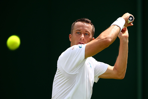 LONDON, ENGLAND - JUNE 27:  Phillip Kohlschreiber of Germany plays a backhand shot during the Men's Singles first round match against Pierre-Hugues Herbert of France on day one of the Wimbledon Lawn Tennis Championships at the All England Lawn Tennis and Croquet Club on June 27th, 2016 in London, England.  (Photo by Clive Brunskill/Getty Images)