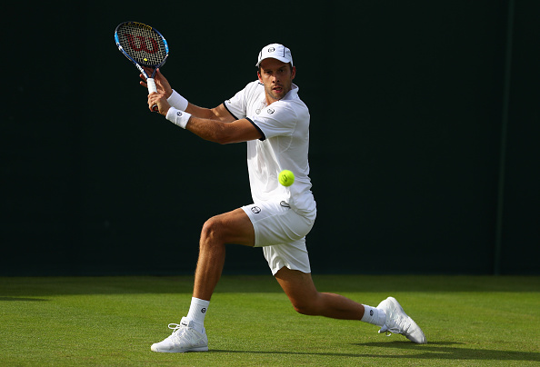 LONDON, ENGLAND - JUNE 27:  Gilles Muller of Luxenbourg plays a backhand shot during the Men's Singles first round  against Santiago Giraldo of Columbia on day one of the Wimbledon Lawn Tennis Championships at the All England Lawn Tennis and Croquet Club on June 27th, 2016 in London, England.  (Photo by Julian Finney/Getty Images)