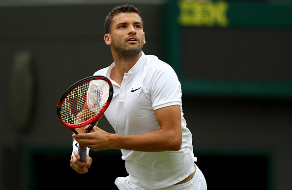 LONDON, ENGLAND - JUNE 30:  Grigor Dimitrov of Bulgaria looks on during the Men's Singles second round match against Gilles Simon of France on day four of the Wimbledon Lawn Tennis Championships at the All England Lawn Tennis and Croquet Club on June 30, 2016 in London, England.  (Photo by Julian Finney/Getty Images)