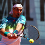MADRID, SPAIN - MAY 03:  Fabio Fognini of Italy plays a backhand against Bernard Tomic of Australia in their first round match during day four of the Mutua Madrid Open tennis tournament at the Caja Magica on May 03, 2016 in Madrid,Spain.  (Photo by Clive Brunskill/Getty Images)