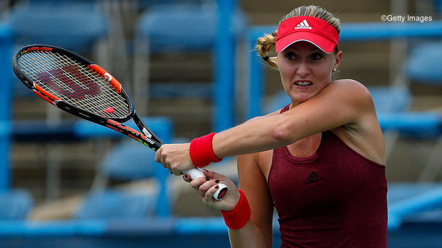 WASHINGTON, DC - JULY 21: Kristina Mladenovic of France returns a shot to Sabine Lisicki of Germany during day 4 of the Citi Open at Rock Creek Tennis Center on July 21, 2016 in Washington, DC. (Photo by Matt Hazlett/Getty Images)