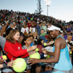 STANFORD, CA - JULY 22: Venus Williams of the United States signs autographs for fans after a win against Catherine Bellis of the United States during day five of the Bank of the West Classic at the Stanford University Taube Family Tennis Stadium on July 22, 2016 in Stanford, California. (Photo by Lachlan Cunningham/Getty Images)