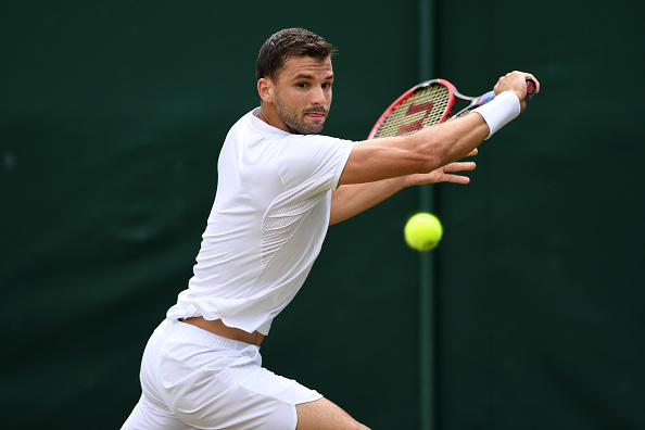 LONDON, ENGLAND - JULY 02:  Grigor Dimitrov of Bulgaria during the plays a backhand against Steve Johnson of The United States on day six of the Wimbledon Lawn Tennis Championships at the All England Lawn Tennis and Croquet Club on July 2, 2016 in London, England.  (Photo by Shaun Botterill/Getty Images)