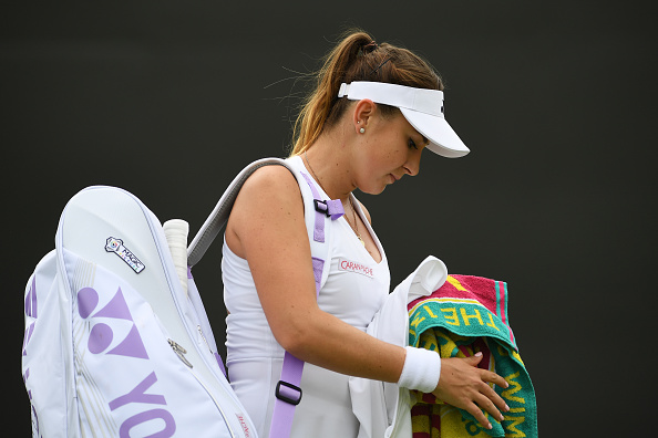 LONDON, ENGLAND - JUNE 30:  Belinda Bencic of Switzerland retires due to an injury during the Ladies Singles second round match  against Julia Boserup of the United States on day four of the Wimbledon Lawn Tennis Championships at the All England Lawn Tennis and Croquet Club on June 30, 2016 in London, England.  (Photo by Shaun Botterill/Getty Images)