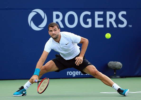 TORONTO, ON - JULY 25:  Grigor Dimitrov of Bulgaria plays a shot against Yuichi Sugita of Japan during Day 1 of the Rogers Cup at the Aviva Centre on July 25, 2016 in Toronto, Ontario, Canada.  (Photo by Vaughn Ridley/Getty Images)