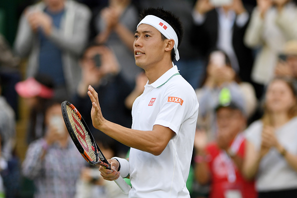 LONDON, ENGLAND - JULY 02:  Kei Nishikori of Japan celebrates victory during the Men's Singles third round match against Alexander Kudryavtsev of Russia on day six of the Wimbledon Lawn Tennis Championships at the All England Lawn Tennis and Croquet Club on July 2, 2016 in London, England.  (Photo by Shaun Botterill/Getty Images)