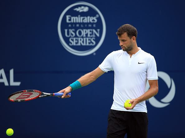TORONTO, ON - JULY 25:  Grigor Dimitrov of Bulgaria prepares to serve against Yuichi Sugita of Japan during Day 1 of the Rogers Cup at the Aviva Centre on July 25, 2016 in Toronto, Ontario, Canada.  (Photo by Vaughn Ridley/Getty Images)