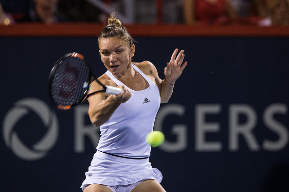 MONTREAL, ON - JULY 26:  Simona Halep of Romania hits a return against Daria Gavrilova of Australia during day two of the Rogers Cup at Uniprix Stadium on July 26, 2016 in Montreal, Quebec, Canada.  Simona Halep of Romania defeated Daria Gavrilova of Australia 2-6, 3-6.  (Photo by Minas Panagiotakis/Getty Images)