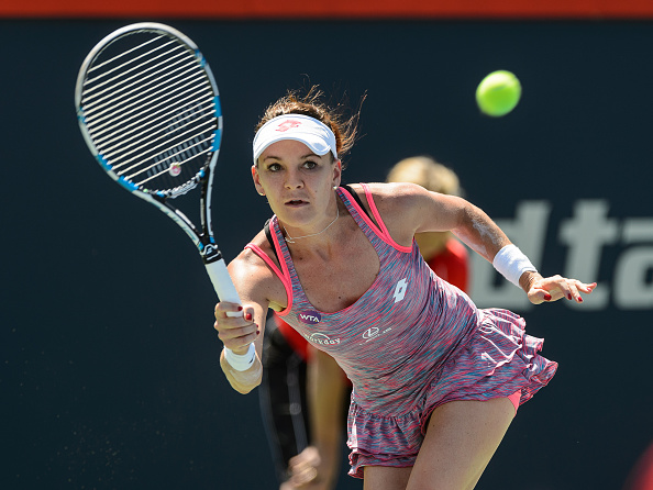 MONTREAL, ON - JULY 27:  Agnieszka Radwanska of Poland returns the ball against Monica Niculescu of Romania during day three of the Rogers Cup at Uniprix Stadium on July 27, 2016 in Montreal, Quebec, Canada.  (Photo by Minas Panagiotakis/Getty Images)