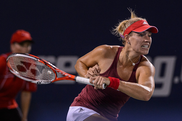 MONTREAL, ON - JULY 27:  Angelique Kerber of Germany hits a return against Mirjana Lucic-Baroni of Croatia during day three of the Rogers Cup at Uniprix Stadium on July 27, 2016 in Montreal, Quebec, Canada.  (Photo by Minas Panagiotakis/Getty Images)