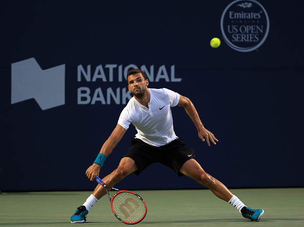 TORONTO, ON - JULY 27:  Grigor Dimitrov of Bulgaria hits a shot against Denis Shapovalov of Canada on Day 3 of the Rogers Cup at the Aviva Centre on July 27, 2016 in Toronto, Ontario, Canada.  (Photo by Vaughn Ridley/Getty Images)