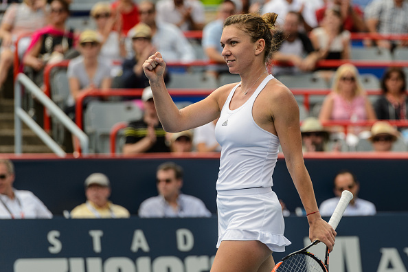 MONTREAL, ON - JULY 29:  Simona Halep of Romania celebrates her victory over Svetlana Kuznetsova of Russia during day five of the Rogers Cup at Uniprix Stadium on July 29, 2016 in Montreal, Quebec, Canada.  Simona Halep defeated Svetlana Kuznetsova 6-3, 1-6, 1-6.  (Photo by Minas Panagiotakis/Getty Images)