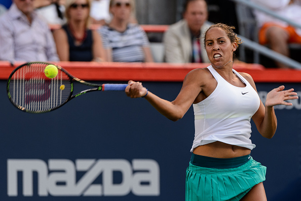 MONTREAL, ON - JULY 29:  Madison Keys of the United States hits a return against Anastasia Pavlyuchenkova of Russia during day five of the Rogers Cup at Uniprix Stadium on July 29, 2016 in Montreal, Quebec, Canada.  (Photo by Minas Panagiotakis/Getty Images)