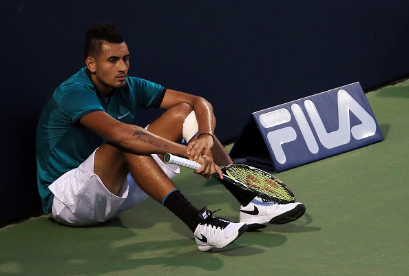 TORONTO, ON - JULY 25:  Nick Kyrgios of Australia sits at the end of the court and waits for the final game in his match against Denis Shapovalov of Canada during Day 1 of the Rogers Cup at the Aviva Centre on July 25, 2016 in Toronto, Ontario, Canada.  (Photo by Vaughn Ridley/Getty Images)