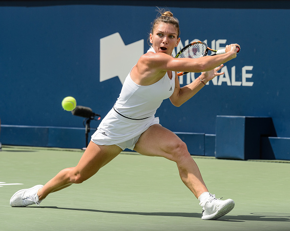 MONTREAL, ON - JULY 30:  Simona Halep of Romania hits a return against Angelique Kerber of Germany during day six in semifinal round action of the Rogers Cup at Uniprix Stadium on July 30, 2016 in Montreal, Quebec, Canada.  Simona Halep defeated Angelique Kerber 6-0, 3-6, 6-2.  (Photo by Minas Panagiotakis/Getty Images)
