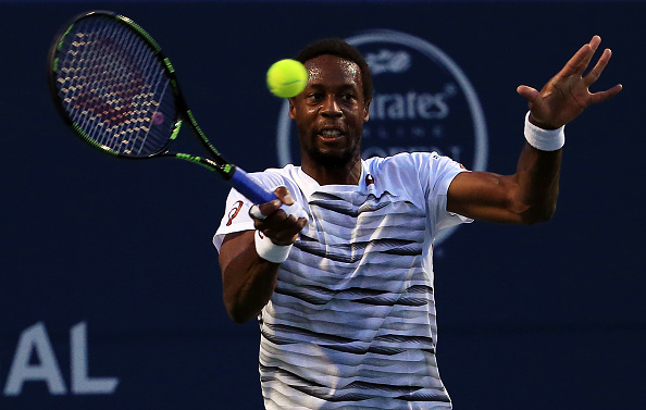 TORONTO, ON - JULY 30:  Gael Monfils of France hits a shot against Novak Djokovic of Serbia during Day 6 of the Rogers Cup at the Aviva Centre on July 30, 2016 in Toronto, Ontario, Canada.  (Photo by Vaughn Ridley/Getty Images