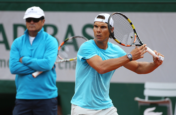 PARIS, FRANCE - MAY 22: Rafael Nadal of Spain is practicing while his coach/uncle Toni Nadal looks on prior to the French Open 2015 at Roland Garros stadium on May 22, 2015 in Paris, France. (Photo by Jean Catuffe/Getty Images)