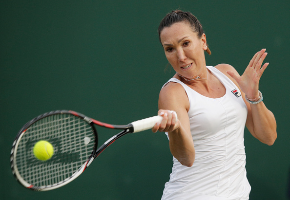 LONDON, ENGLAND - JUNE 27:  Jelena Jankovic of Serbia plays a forehand shot during the Men's Singles first round against Stefanie Voegele of Switzerland  on day one of the Wimbledon Lawn Tennis Championships at the All England Lawn Tennis and Croquet Club on June 27th, 2016 in London, England.  (Photo by Adam Pretty/Getty Images)