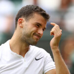 LONDON, ENGLAND - JUNE 30:  Grigor Dimitrov of Bulgaria reacts during the Men's Singles second round match against Gilles Simon of France on day four of the Wimbledon Lawn Tennis Championships at the All England Lawn Tennis and Croquet Club on June 30, 2016 in London, England.  (Photo by Julian Finney/Getty Images)