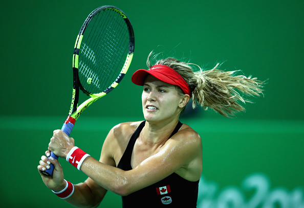 RIO DE JANEIRO, BRAZIL - AUGUST 06:  Eugenie Bouchard of Canada in action against Sloane Stephens of the United States in their first round match on Day 1 of the Rio 2016 Olympic Games at the Olympic Tennis Centre on August 6, 2016 in Rio de Janeiro, Brazil.  (Photo by Clive Brunskill/Getty Images)