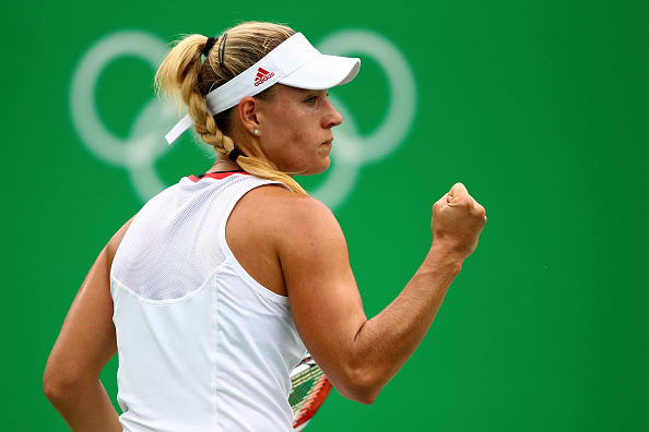 RIO DE JANEIRO, BRAZIL - AUGUST 07:  Angelique Kerber of Germany reacts after winning a point against Mariana Duque-Marino of Colombia in their first round match on Day 2 of the Rio 2016 Olympic Games at the Olympic Tennis Centre on August 7, 2016 in Rio de Janeiro, Brazil.  (Photo by Clive Brunskill/Getty Images)