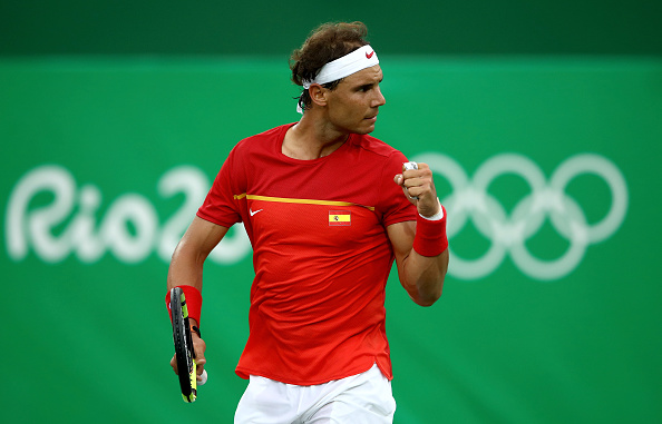 RIO DE JANEIRO, BRAZIL - AUGUST 07:  Rafael Nadal of Spain reacts after winning a point against Federico Delbonis of Argentina in their first round match on Day 2 of the Rio 2016 Olympic Games at the Olympic Tennis Centre on August 7, 2016 in Rio de Janeiro, Brazil.  (Photo by Cameron Spencer/Getty Images)