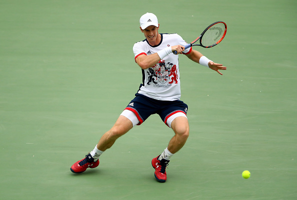 RIO DE JANEIRO, BRAZIL - AUGUST 07:  Andy Murray of Great Britain plays a forehand against Viktor Troicki of Serbia in their first round match on Day 2 of the Rio 2016 Olympic Games at the Olympic Tennis Centre on August 7, 2016 in Rio de Janeiro, Brazil.  (Photo by Clive Brunskill/Getty Images)