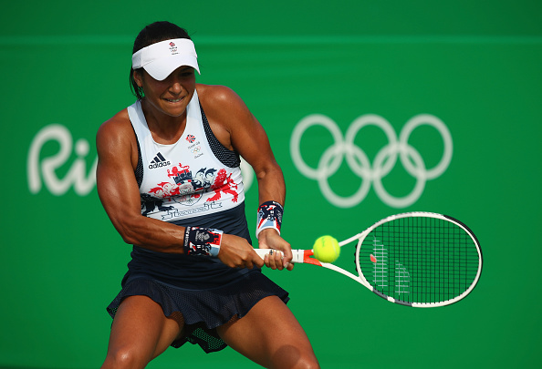 RIO DE JANEIRO, BRAZIL - AUGUST 06:  Heather Watson of Great Britain plays a backhand against Shuai Peng of China in their first round match on Day 1 of the Rio 2016 Olympic Games at the Olympic Tennis Centre on August 6, 2016 in Rio de Janeiro, Brazil.  (Photo by Clive Brunskill/Getty Images)