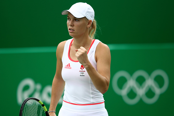 RIO DE JANEIRO, BRAZIL - AUGUST 07:  Caroline Wozniacki of Denmark reacts after winning a point  against Lucie Hradecka of Czech Republic in their first round match on Day 2 of the Rio 2016 Olympic Games at the Olympic Tennis Centre on August 7, 2016 in Rio de Janeiro, Brazil.  (Photo by Cameron Spencer/Getty Images)