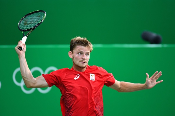 RIO DE JANEIRO, BRAZIL - AUGUST 07: Goffin David of Belgium competes Groth Sam of Australia during the men's singles first round match at the Olympic Tennis Centre during the Rio 2016 Summer Olympic Games on August 07, 2016 in Rio de Janeiro, Brazil. 7/08/2016 (Photo by Vincent Kalut / Photonews  via Getty Images)